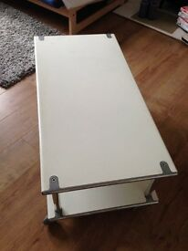 - white metal table with wheels -