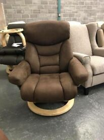 Brown faux suede reclining chair and footstool