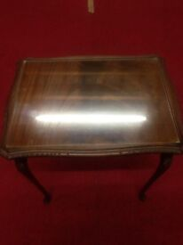 second hand small side table with glass covering