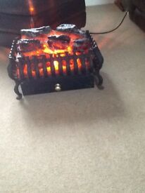 Electric fan heater in wrought iron basket
