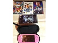 PSP handheld with games and charger