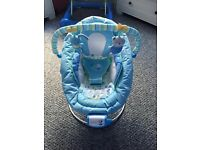 Baby boys bouncer vibrates and plays music