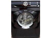 clean black hotpoint washing machine