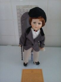 porcelain doll on a stand called riding height is 14 inch approx