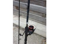 2 fishing rods and reels plus rod rest and tackle
