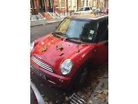 Red Mini Cooper 2005 with very low mileage in excellent condition