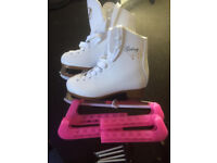Junior ice skates size 12, brand new and never used