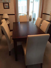 Sterling furniture dining table and 6 chairs