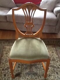 Yew dining room table, 6 chairs and 2 carver chairs. Excellent condition.