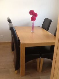 Solid Oak dining table and 4 brown leather chairs, excellent condition