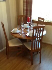 Extendable dining table and four chairs, entertainment unit and sideboard