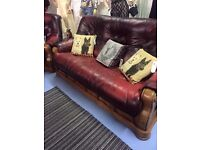Blood red leather sofa