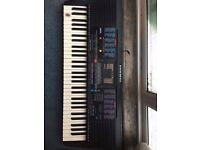 YAMAHA KEYBOARD IN GOOD CONDITION; STAND INCLUDED
