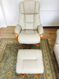 Designer Italian leather Swivel Relaxer Chair With Foot Stool In Cream