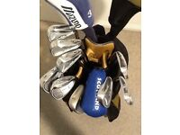Mizuno, Titleist, Ping and Cobra set of clubs.