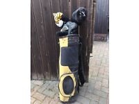 One set of golf clubs in bag