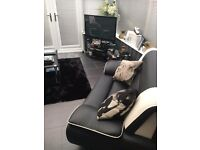 3+2 leather sofa's with coffee table. Tv stand and nest of tables