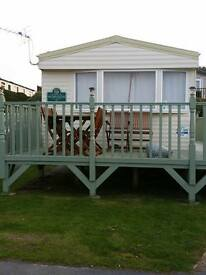 8 berth static caravan new quay haven site. Site fees paid till march 2017
