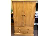 SOLID PINE CHILD'S WARDROBE WITH DRAWS