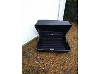 Black car roof box with roof mounting brackets very good condition
