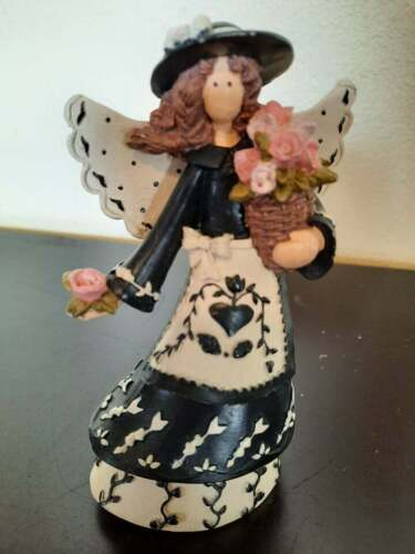 Resin angel in black & White with basket of flowers