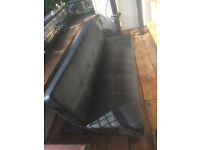 Black, leather sofa convertible - central London