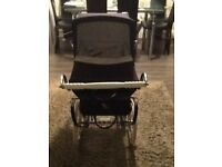 Dolls SilverCross pram with bag,tray and pram set. Navy with patterned interior.