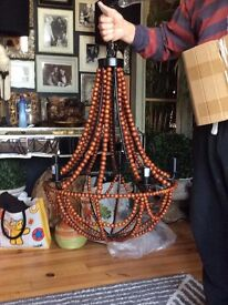 Large wooden beads and metal chandelier