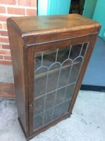 Glass storage cupboard for sale with key