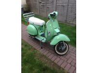 Vespa lml 125 2009 1600 miles from new with mot!
