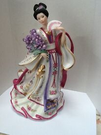 Porcelain figure from The Danbury Mint collection