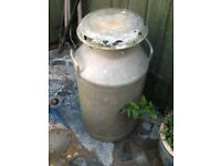 A VINTAGE MILK CHURN MADE BY UNIGATE FROM THE 1960s