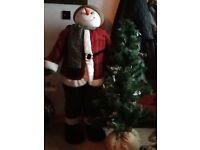 BIG SNOWMAN HOLDING A CHRISTMAS TREE