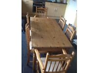 Kitchen table and 6 chairs in antique pine. In need of some TLC. £75. Buyer to collect.
