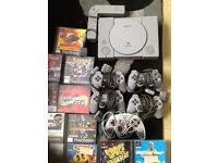 PlayStation 1 console with 15 games