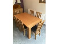 Oak wood dining table and six chairs