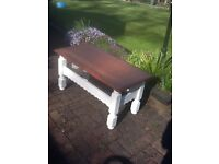 Heavy oak coffee table with white painted legs