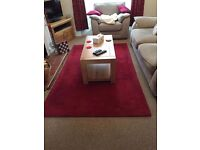 Good quality raspberry-red wool rug for sale