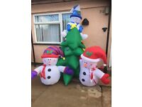 inflatable Christmas tree and two snowmen. This Christmas tree has lights on it that light up
