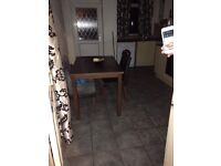wooden dining table and 4 brown leather chairs