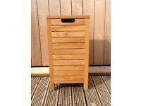 Wooden laundry basket, for sale at £35 in good condition.