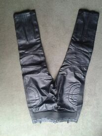 "Leather motorcycle trousers. 36"" waist, 32"" long. Great condition."