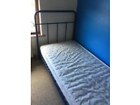 Blue metal frame single bed with mattress from NEXT