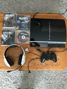 Playstation 3 with 4 games 1 controller and wireless headphones