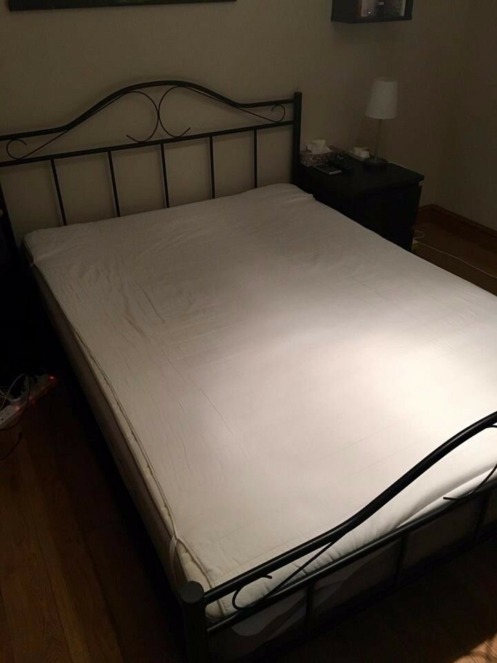 Double bed with mattress and mattress cover