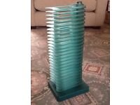 Stylish CD tower holds 25 CDs. Can swivel each tier out for easy access.