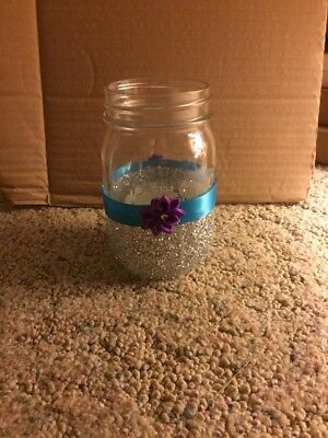 mason jars half covered in glitter with turquose ribbion and anpurple flower dec](Flowers In Mason Jars)