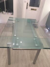 Dining table glass and chrome , seats 4 - 6, extends. Beautiful and contemporary.