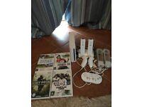 Nintendo Wii + Rockband instruments + games