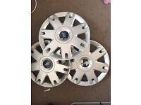 "GENUINE FORD 15"" wheel trims, set of 3."